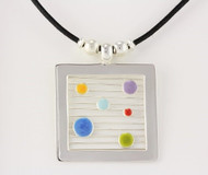 """""""Large Square Pendant with Dots"""" by Ann Carol Jewelry from Boundbrook, NJ. Each piece is made with sterling silver and accented with hand painted enamel designs with waxed cotton cord."""