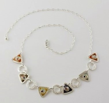 """Triangle & Circle Link Necklace"" Each piece is made with sterling silver and accented with hand painted enamel designs & neutral crystal inlay."