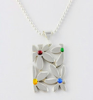 """Cutout Flowers Pendant"" by Ann Carol Jewelry based in Boundbrook, NJ. Each piece is made with sterling silver and accented with hand painted enamel designs on a 18 Inch Bead Chain."