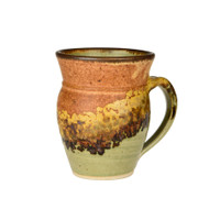 This Large Round Mug  is hand made by John Vela.  Due to the handmade nature of the pottery, expect slight differences from item to item with respect to size, shape, and glaze, even within sets of items.  Shown in Safari glaze.