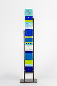 "Medium Standing Totem in Water by Hands On Art Glass. 4""x30"", fused glass in a grey metal stand. Please call our galleries to see which pieces are currently on hand."