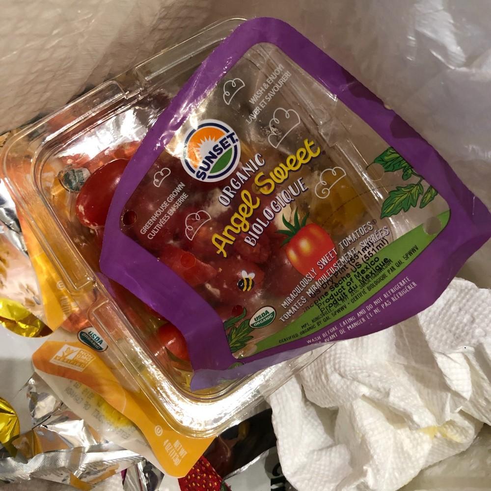 Plastic tomato container in the trash