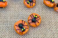 1 | Black Widow Spider on Orange Lampwork Glass Bead