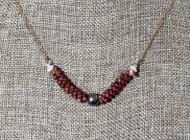 "3 2/16"" burgundy Kahelelani shells and Tahitian pearl finding #104"