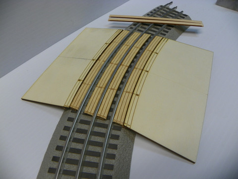 ASSEMBLED GRADE CROSSING WITH RAMPS. NOTE: this listing is for the RAMPS only see additional photo.  Crossing (center boards between track) must be purchased separately.