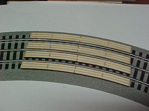 "31"" Curved crossing for Lionel Fastrack Sectional Track.  Makes One (1) two (2) lane automobile crossing for road across track. See other listing for special Auto Ramps for this crossing.  Smooths the transition for cars to cross tracks."