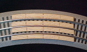 """48"""" Curved crossing for Lionel Fastrack Sectional Track.  Makes One (1) two (2) lane automobile crossing for road across track. See other listing for special Auto Ramps for this crossing.   Smooths the transition for cars to cross tracks."""