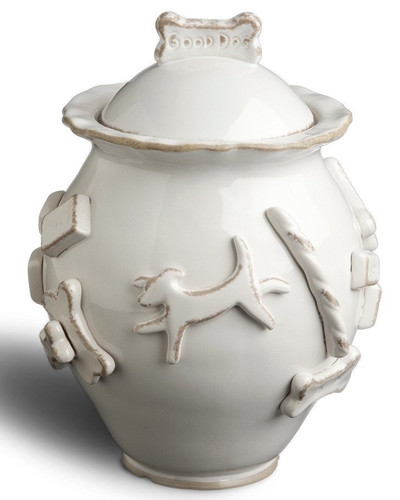 "Your dog is a family member so why not have her/his own cookie jar?  Our ceramic stoneware jars are hand decorated with raised appliques all around each vessel and are airtight.  Available in three colors: Baby Blue, Caramel, French White and Green.  Measures 7 1/2"" to the rim, and 9 1/2 "" to the ""Good Dog"" cookie on top.  About 7"" wide. Designed in a Carmel California Studio."