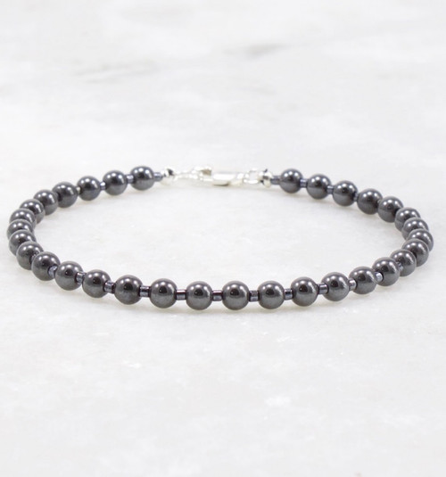 Hematite bracelet of 4mm round stones.  Sterling silver lobster claw clasp measuring 7 inches long.