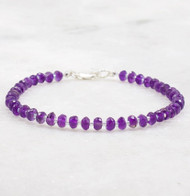 Amethyst bracelet using 4mm faceted rondelles, ultra violet in color.  Sterling silver lobster claw clasp and 7 inches long.