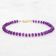 Amethyst bracelet with a 14k gold filled lobster claw clasp, 7 inches long.