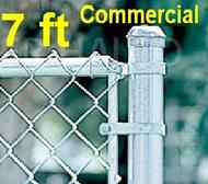 "7 ft tall Galvanized Commercial Fence Kit, Plain or Barb Wire Top. Includes: Line Posts (2"" OD x 9 ft spaced at 10ft) with hardware, Top Rail (1-5/8""), Mesh (2"" x 9 gauge). Corner, End, Gate Posts and gates not included.  Price is per ft."