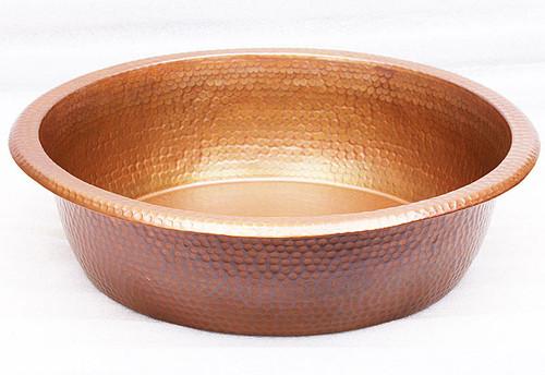 Small hammered copper pedicure spa foot soak bowl.