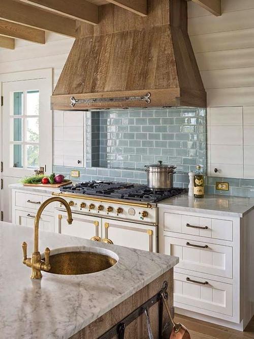 Round hammered rustic brass bar sink installation.