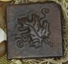 Copper tile with grape leaf design