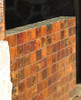 Hammered copper tiles in fired patina on outside bar wall