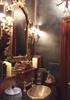 Oval bath sink with custom fox in weathered brass
