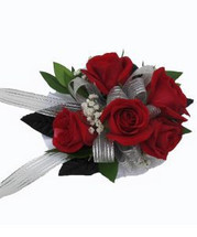 Red spray rose wrist corsage in Rockville MD, Palace Florists