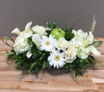 Crisp white flowers with green apple is fun centerpiece for any occasion in Rockville MD, Palace Florists