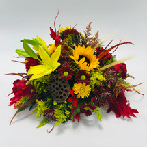 Falling leaves with a mix of sunflowers, lilies, roses, pods, leaves and wheat in low container  in Rockville MD, Palace Florists