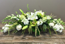 Rustic Memories showcases green and white flowers such as lilies, cymbidiums, roses and stock in rectangular wood box in Washington DC and Rockville MD, Palace Florists