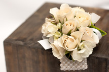 White roses wrist corsage with pearl bracelet in Washington DC and Rockville MD, Palace Florists