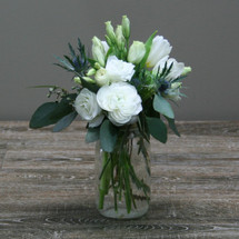 Garden Chic showcases white ranuculas, white lysinathis, white tulips, thistle and foliage in a mason jar in Washington DC and Rockville MD, Palace Florists