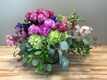 Spring Garden filled with roses, hydrangea and other spring flowers in glass cylinder in Rockville MD, Palace Florists