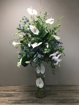 Buffet Piece showcases white anthurium. white callas, white orchids accented with other white flowers and beautiful foliage in a cylinder with complementing flowers  in Rockville MD, Palace Florists