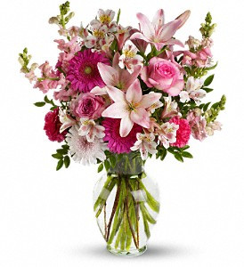 Lucky in Love showcases pink roses, pink asiatic lilies, hot pink gerberas, light pink alstroemeria, hot pink carnations, pink snapdragons and lavender chrysanthemums accented with fresh greenery in a clear glass vase in Rockville MD, Palace Florists