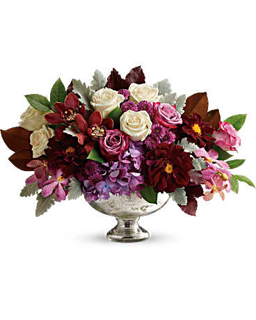 Beautiful Harvest features purple hydrangea, red cymbidium orchids, purple mokara orchids, crème roses, lavender roses, burgundy dahlias, purple button spray chrysanthemums and beautiful foliage in a Mercury glass bowl in Bethesda MD, Palace Florists