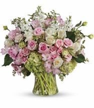 Beautiful Love Bouquet features green hydrangea, pink roses, white roses, pink spray roses, light pink alstroemeria, pink lisianthus, white stock and foliage arranged in a large gathering vase in Rockville MD, Palace Florists