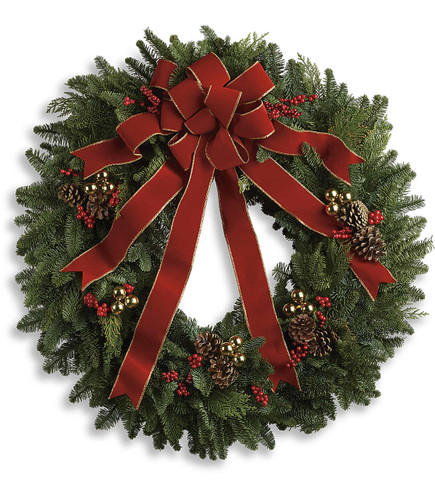 Classic Holiday Wreath is designed on a beautiful noble fir wreath with juniper branches, pinecones and berry sprays is adorned with a brilliantly festive red velvet bow in Bethesda MD, Palace Florists