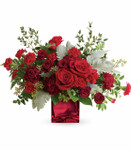 Rich in Love showcases red roses, red spray roses, carnations, miniature carnations and a beautiful variety of foliage designed in a red glass cube in Rockville MD, Palace Florists