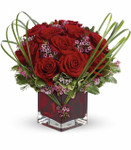 Sweet Thoughts Bouquet showcases red roses and purple waxflower in a red glass cube in Rockville MD, Palace Florists