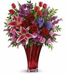 One of a Kind Love bouquet showcases red roses, red tulips, pink stargazer lilies, purple alstroemeria, pink miniature carnations, and lavender hyacinth are arranged with pink heather and a variety of foliage in a beautiful Love's Passion vase in Rockville MD, Palace Florists