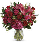 Love Struck Bouquet features pink hydrangea, hot pink roses, red roses, dark pink asiatic lilies, dark pink alstroemeria, maroon carnations and a variety of foliage in a glass vase in Rockville MD, Palace Florists