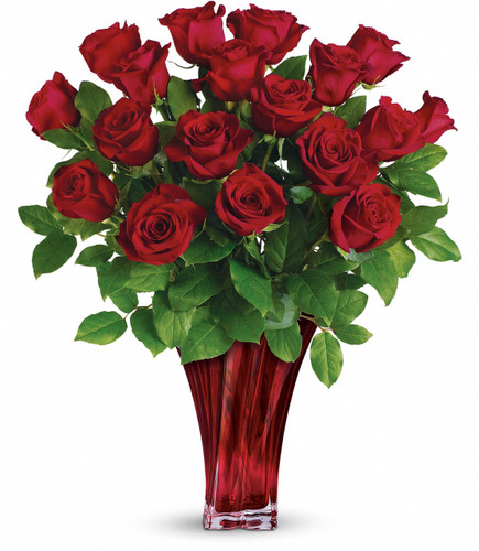 Legendary Love Bouquet showcases 18 red roses with foliage in a beautiful red glass vase hand delivered in Rockville MD, Palace Florists