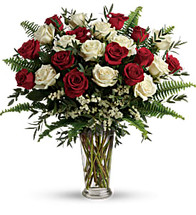 Yours Truly showcases red and white roses in a beautiful glass vase in Rockville MD, Palace Florists