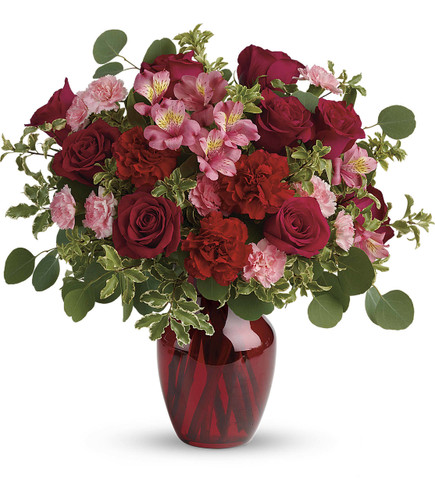 Blooming Belles showcases roses, alstromeria, carnations, silver dollar eucalyptus and other foliage in a red vase in Rockville MD, Palace Florists