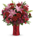 Satin Kisses Bouquet showcases roses, lilies, alstromeria, carnations and beautiful foliage in a red sating finish ceramic vase in Rockville MD, Palace Florists