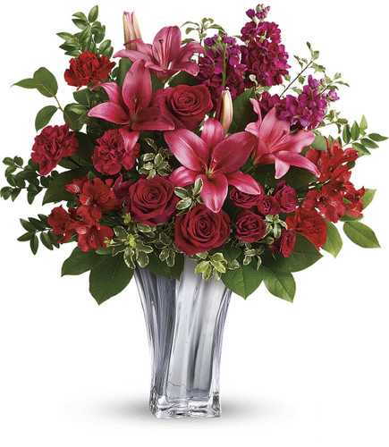 Sterling Love Bouquet features roses, lilies, alstromeria, carnations, stock and beautiful foliage in a sterling silver mirrored blown glass vase in Rockville MD, Palace Florists