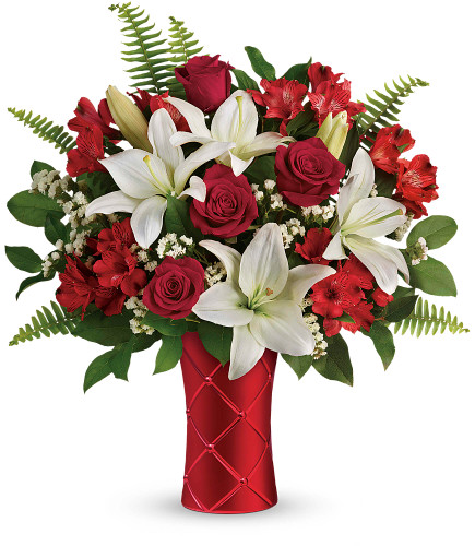 Sweetest Satin bouquet showcases red roses, white asiatic lilies, red alstroemeria, and white statice designed with beautiful foliage in a soft, red quilted style vase in Rockville MD, Palace Florists