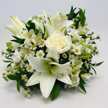Rosh Hashana Whites centerpiece showcases roses, lilies, alstromeria, monte casino and foliage in Rockville MD, Palace Florists