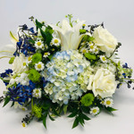 Traditions showcases white roses, white lilies, blue hydrangea, blue delphinium and other flowers and foliage in Rockville MD, Palace Florists