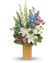 Nature's Best Bouquet showcase the natural beauty of snow white lilies and sky blue delphinium, artfully arranged in a modern vase of natural bamboo in Rockville MD, Palace Florists