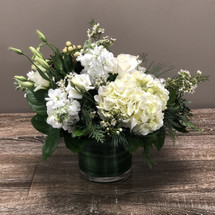 Snowflakes on the Potomac features white hydrangea, white stock, white lysianthis, creme berries and foliage in Potomac MD, Palace Florists