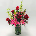 Rockville Romance is a beautiful array of romantic flowers featuring roses, lilies, snapdragon delphinium and wax flower in a glass cylinder in Rockville MD, Palace Florists