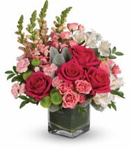 Garden Girl showcases roses, spray roses, alstroemeria, pink miniature carnations, button mums and pink snapdragons are arranged with foliage in glass cube vase in Rockville MD, Palace Florists