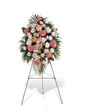 Gentle Thoughts Spray showcases pink carnations, white spray chrysanthemums and rose accents with a pink ribbon on an easel in Washington DC and Rockville MD, Palace Florists